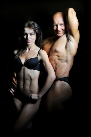 female bodybuilder: man and a woman in the gym Stock Photo