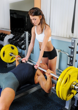 a young old couple: man and a woman in the gym Stock Photo