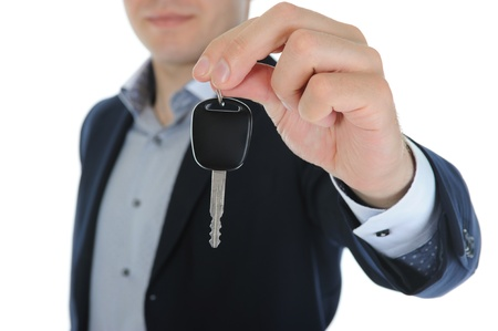 generosity: Empresario da las claves para el coche Foto de archivo