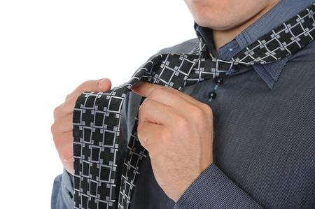 Businessman tying his tie photo