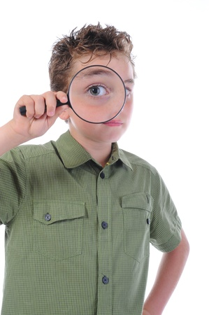 boy looking through a magnifying glass photo