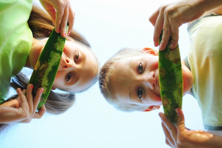 Young girl and boy eating watermelon Stock Photo - 11342963
