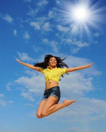 Beautiful Woman over blue Sky Stock Photo - 11343021