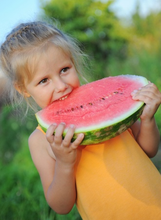 Young girl eating watermelon Stock Photo - 11342969