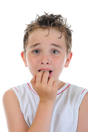 panic: Portrait of a frightened boy Stock Photo