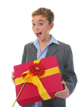 boy with a gift box and a flower photo
