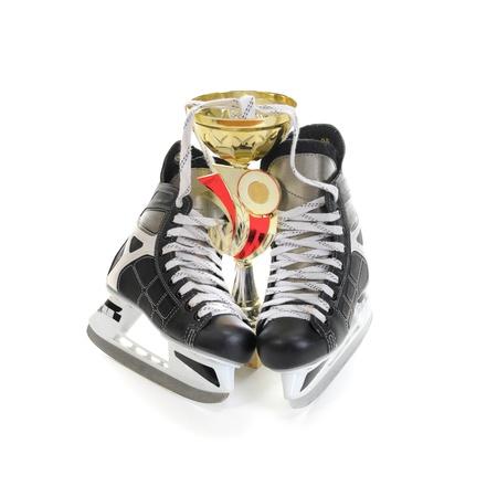 Hockey skates and cup winner photo