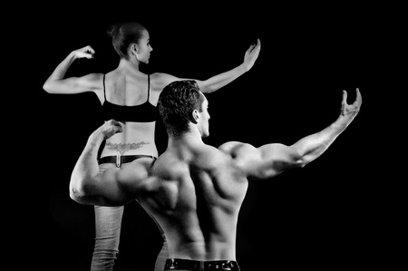 fitness couple: man and a woman in the gym Stock Photo