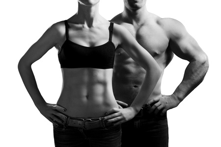 tummy: man and a woman in the gym Stock Photo