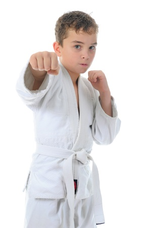 child feet: Young boy training karate. Stock Photo