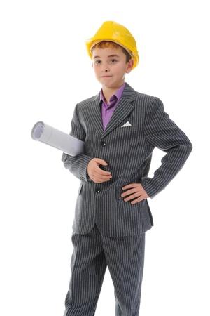 protective suit: Little smiling builder in helmet Stock Photo