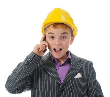 Little smiling builder in helmet photo