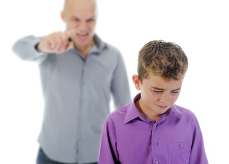 defiant: Strict father punishes his son Stock Photo