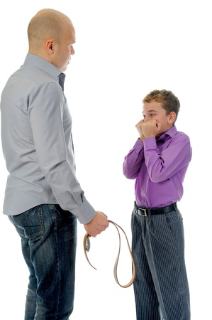 Strict father punishes his son photo