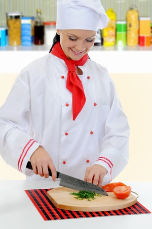 Chef cuts the tomato Stock Photo - 11360135