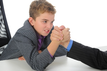 boy and a man arm wrestling photo