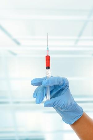 dr: syringe in dr hand.