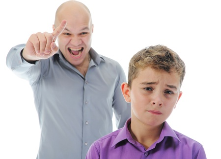 parents with baby: Strict father punishes his son Stock Photo