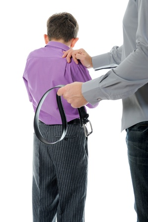 furious: Strict father punishes his son Stock Photo