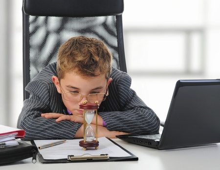 Young businessman using a laptop Stock Photo - 11360943