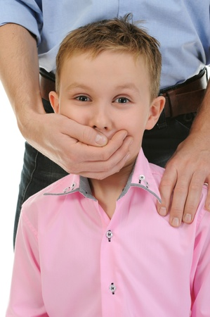 man closes a mouth a hand to the boy Stock Photo - 11360941