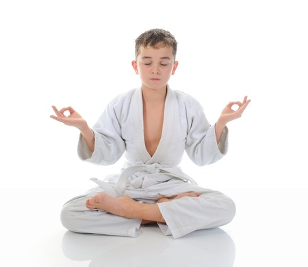 Young boy training karate. Stock Photo