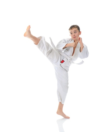 Young boy training karate. Stock Photo - 11361522