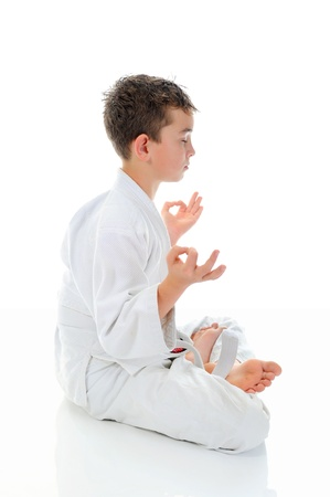 karate fighter: Young boy training karate. Stock Photo