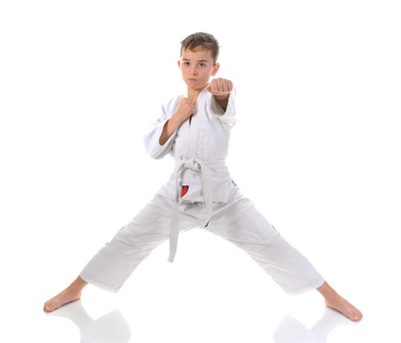 arts backgrounds: Young boy training karate. Stock Photo