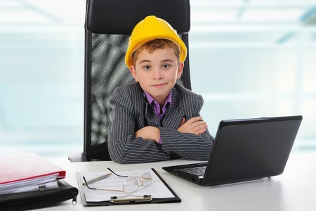 Young businessman using a laptop photo