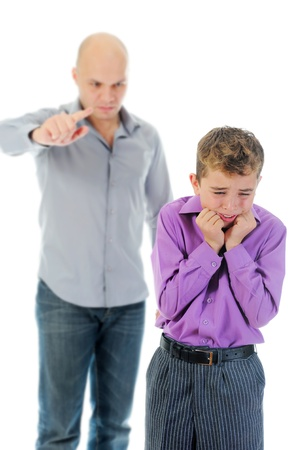family fight: Strict father punishes his son Stock Photo