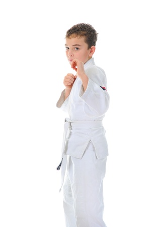 karate boy: Young boy training karate. Stock Photo
