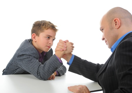 boy and a man arm wrestling photo