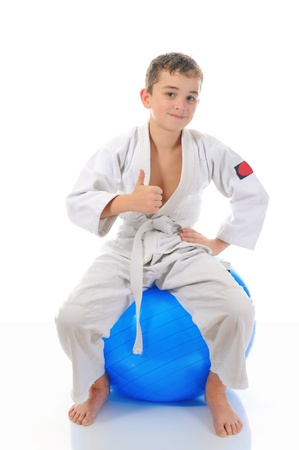 Young boy training karate. photo
