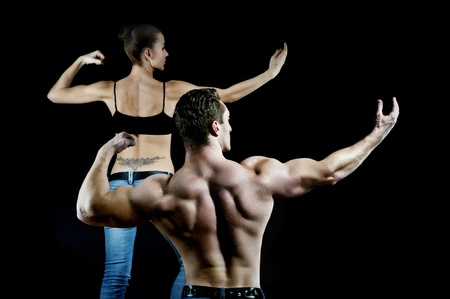 strong arm: man and a woman in the gym Stock Photo