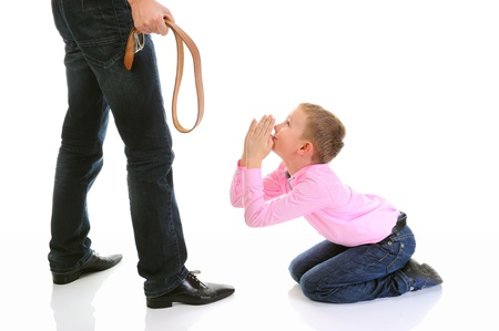 discipline: Strict father punishes his son Stock Photo