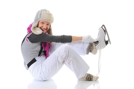 Beautiful girl puts on skates photo