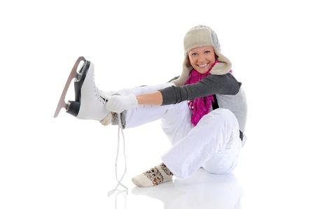 Beautiful girl puts on skates photo