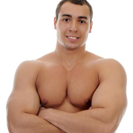 hombres sin camisa: Culturista que muestra sus músculos Foto de archivo