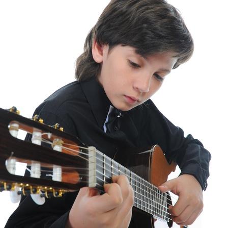 playing the guitar: Little boy musician playing guitar