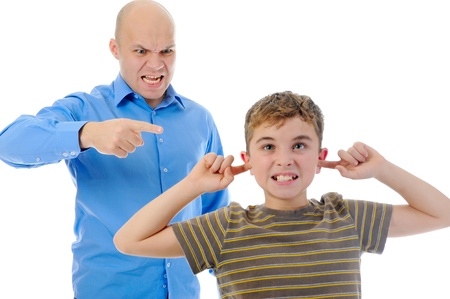 Strict father punishes his son 版權商用圖片