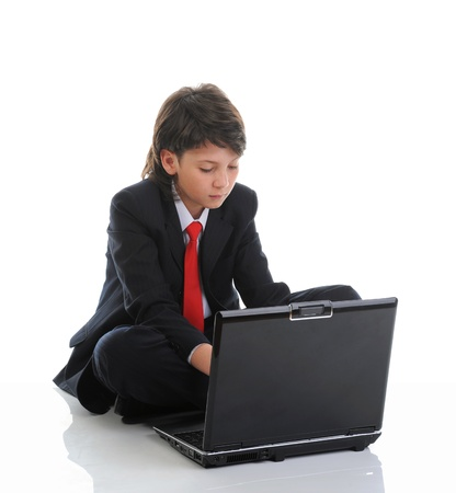 boy in business suit sitting in front of computer photo