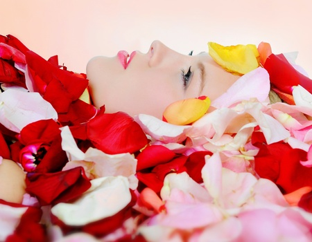 beautiful blonde in rose petals photo