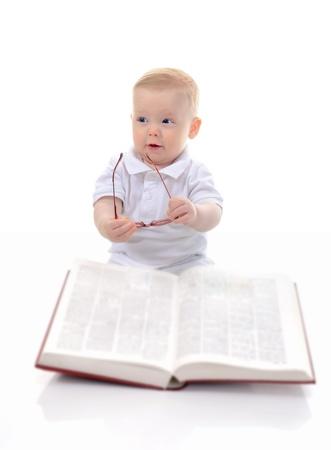 prodigy: Little boy reads a big book