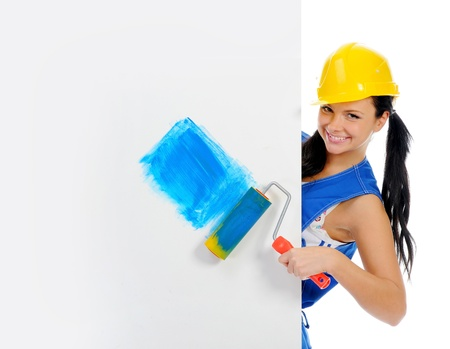Beautiful young woman doing repairs photo