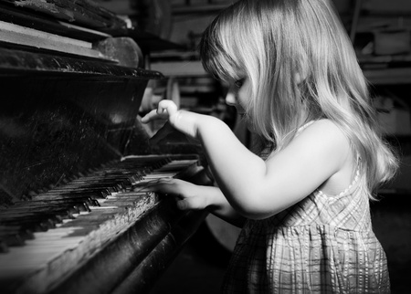 old piano: girl playing on an  piano