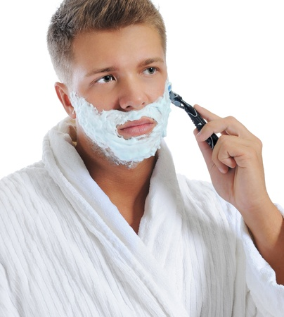 Young man shaving photo