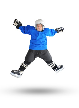 ni�o en patines: Little Boy Jugador de hockey