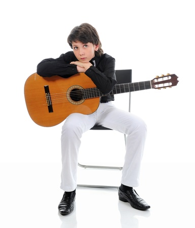 Little boy musician playing guitar photo