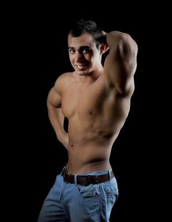 Bodybuilder showing his muscles Stock Photo - 13932824